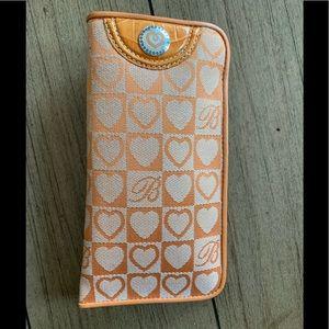Brighton orange cloth glasses case.